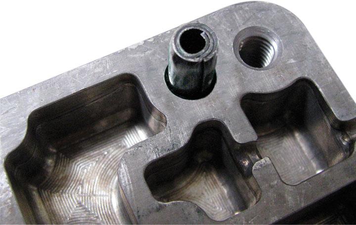 app coiled pin automotive valve body close up top